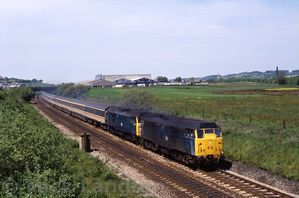 31419___31423_heading_east_with_the_diverted_1A35_1100_Carlisle_-_Euston_28th_May_1989.jpg