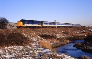 37421_approaching_Blackrod_from_the_west_with__1J03_0706_Blackpool_-_Man_Vic_29th_March_1995.jpg